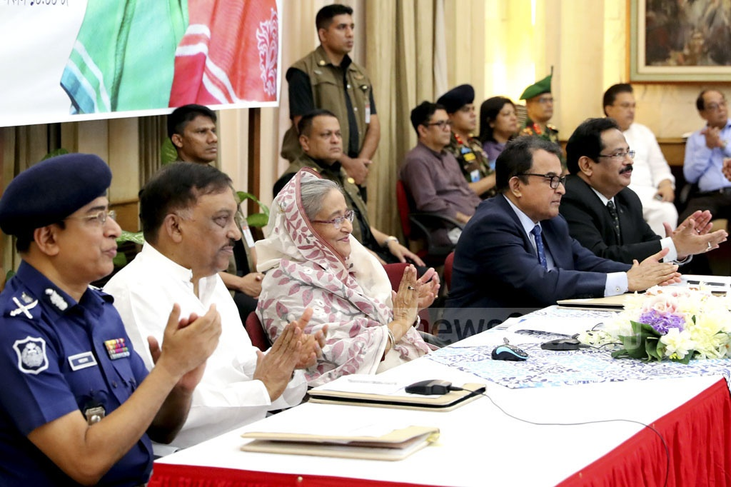Prime Minister Sheikh Hasina inaugurating the Community Bank Bangladesh Limited of Police Welfare Trust through video conferencing from the Ganabhaban on Wednesday. Photo: Saiful Islam Kallol