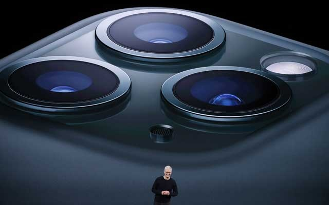 Caption: CEO Tim Cook presents the new iPhone 11 Pro at an Apple event at their headquarters in Cupertino, California, US September 10, 2019. REUTERS