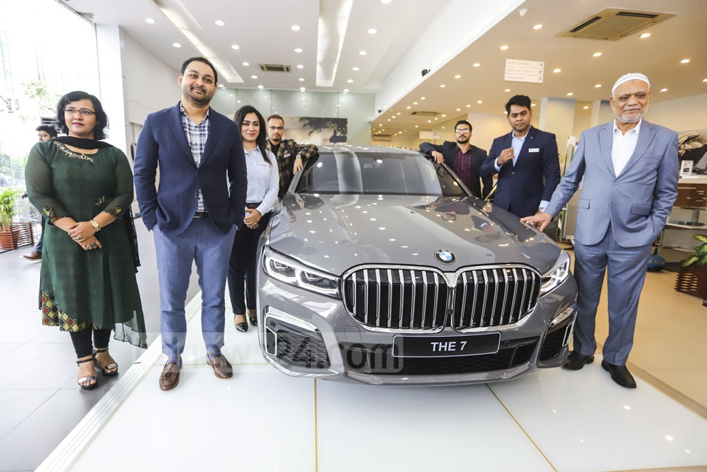 Executive Motors, the authorised dealer of BMW vehicles in Bangladesh, formally unveils the new BMW 7 Series LCI at its showroom in Dhaka's Tejgaon on Thursday. Photo: Asif Mahmud Ove