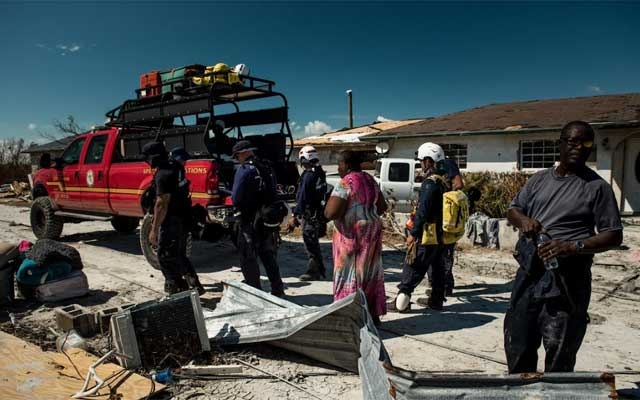 Members of a rescue team from Miami work in McLean's Town, on Grand Bahama, the Bahamas, on Sept. 7, 2019.