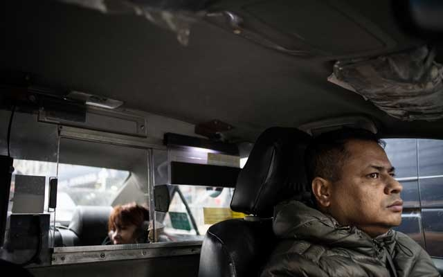 FILE -- Mohammed Hoque, a driver who said he was interviewed by federal agents, and whose debt was so overwhelming that he lost his medallion, carries a passenger in New York, back in Dec 11, 2018. Federal prosecutors in Manhattan have opened an investigation into possible lending fraud in the New York City taxi industry, a response to widespread practices that trapped thousands of cabdrivers under crushing debt, according to people with knowledge of the inquiry. (Kholood Eid/The New York Times)