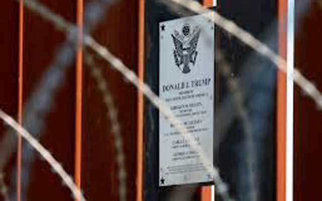 A plaque commemorating US President Donald Trump hangs on the US-Mexico border fence as Trump visits the US-Mexico border in Calexico, California, US, April 5, 2019. REUTERS