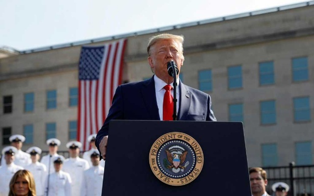 File Photo: US President Donald Trump speaks next to first lady Melania Trump and Defense Secretary Mark Esper during a ceremony marking the 18th anniversary of Sep 11 attacks at the Pentagon in Arlington, Virginia, US, Sep 11, 2019. REUTERS