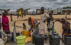 Women and children collect water in the village of Konduga, which hosts a camp for tens of thousands of people fleeing the war with Boko Haram, and was struck by a suicide bombing in June that killed 30 people, in Nigeria, Aug 20, 2019. The New York Times