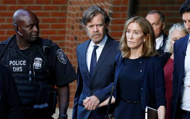 Actress Felicity Huffman leaves the federal courthouse with her husband William H. Macy, after being sentenced in connection with a nationwide college admissions cheating scheme in Boston, Massachusetts, US, Sep 13, 2019. REUTERS