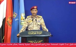A still image from video footage shows Houthi Military Spokesman, Yahya Sarea announces the group's responsibility for the attacks on Aramco facility in the eastern city of Abqaiq, taken from a video broadcasted in Sanaa, Yemen September 14, 2019. AL Masira TV via REUTERS TV