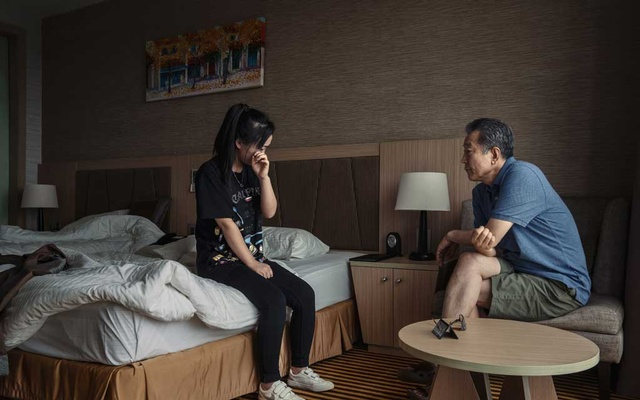 Kim Ye-na, 23, talks to the Rev Chun Ki-won in Vientiane, Laos, on Aug 22, 2019, about the abuse she suffered at the hands of human traffickers in China. Chun helped arrange for her to be smuggled out of China in August. The New York Times