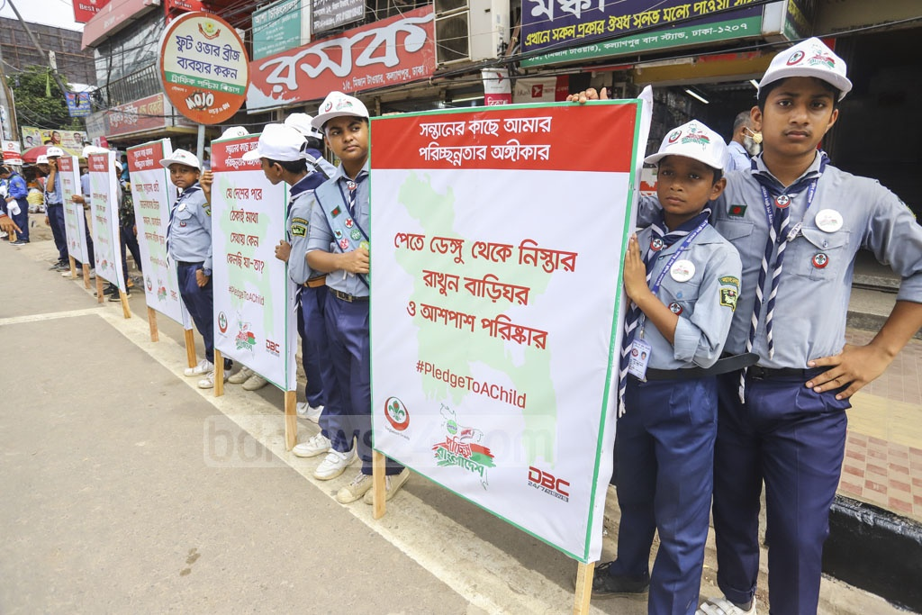 Members of Bangladesh Scouts conduct a public awareness campaign on cleanliness organised by 'Dettol Harpic Porichchonno Bangladesh' at the Kalyanpur Bus Stand in Dhaka on Saturday. Photo: Asif Mahmud Ove