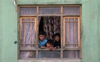 FILE PHOTO: Afghan children look out from a broken window at the site of a blast in Kabul, Afghanistan Sep 3, 2019. REUTERS