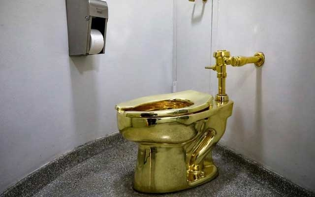 "FILE PHOTO: Maurizio Cattelan's ""America,"" a fully functional solid gold toilet is seen at The Guggenheim Museum in New York City, US, August 30, 2017. Reuters"
