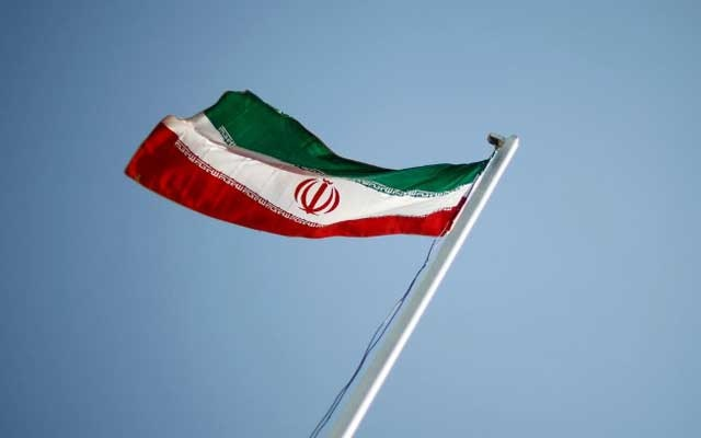 FILE PHOTO: An Iranian national flag flutters during the opening ceremony of the 16th International Oil, Gas & Petrochemical Exhibition (IOGPE) in Tehran Apr 15, 2011. REUTERS/STR/File PhotoREUTERS