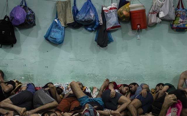 Men arrested for drug crimes are crammed inside a cell in the city of Zubair in Iraq's Basra province, on Jun 20, 2019. Growing addiction is the most recent manifestation of how Iraq's social order has frayed in the years following the 2003 US invasion. The New York Times