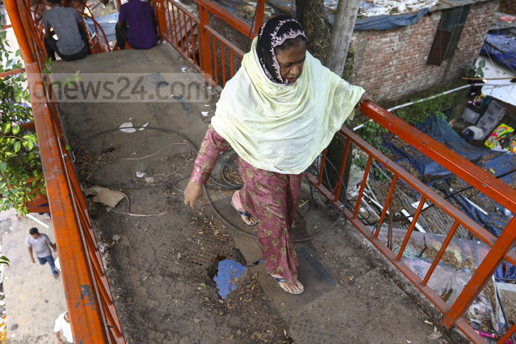 Pedestrians may meet accident if they don't look carefully where they are treading while crossing the footbridge near the flower market at Shahbagh in Dhaka. Photo: Mahmud Zaman Ovi