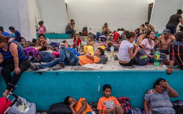 Members of a migrant caravan rest in the town plaza of Escuintla, Chiapas, Mexico, Apr 18, 2019. The New York Times