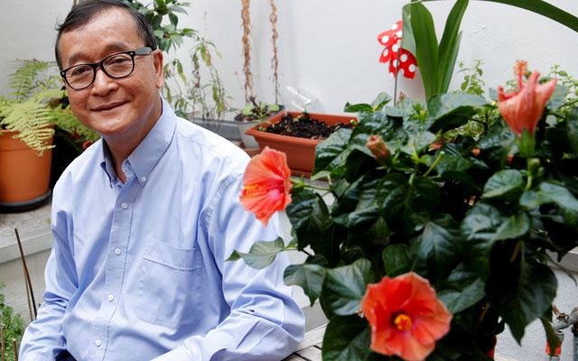 FILE PHOTO: Sam Rainsy, exiled former president of the dissolved opposition Cambodia National Rescue Party (CNRP) Sam Rainsy, poses on his terrace in Paris, France, Jul 19, 2018. REUTERS