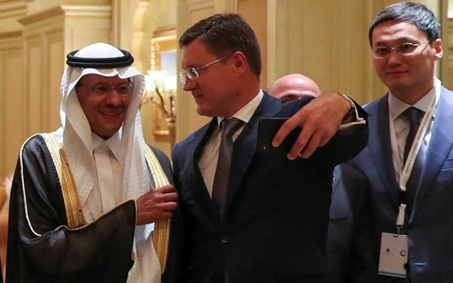 FILE PHOTO: Russia's Energy Minister Alexander Novak and Saudi Arabia's new Energy Minister, Prince Abdulaziz bin Salman take selfie at the joint Ministerial Monitoring Committee in Abu Dhabi, United Arab Emirates Sep 12, 2019. REUTERS