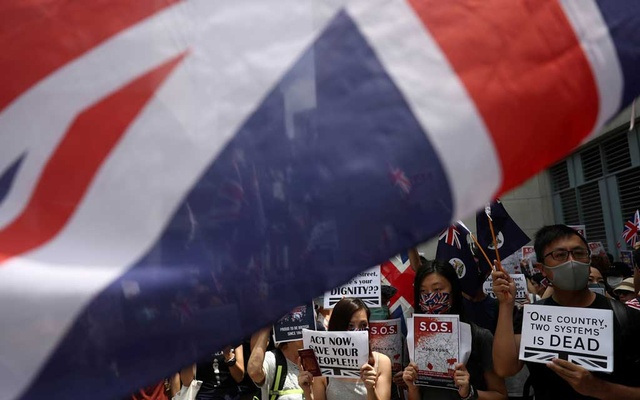 Anti-government protesters hold up banners, placards, Union Jack flags as they gather at the British consulate General in Hong Kong, China, September 15, 2019. Reuters