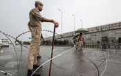 FILE PHOTO: An Indian security personnel stands guard on a deserted road during restrictions after scrapping of the special constitutional status for Kashmir by the Indian government, in Srinagar, Aug 23, 2019. REUTERS