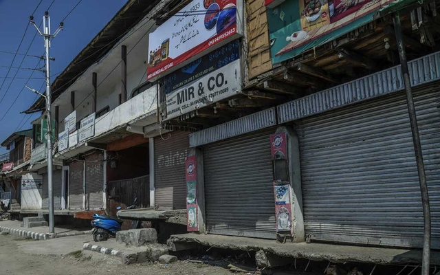 A shuttered store belonging to Ghulam Mohammed Mir, who the separatists fatally shot after he failed to heed warnings to close his business, in Srinagar, India, Sept. 9, 2019. As the crisis in the Kashmir region of India drags into its sixth week, beleaguered Kashmiris are caught between the militant separatists and Indian security forces who, residents say, continue to abuse and torture them.