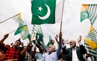 FILE PHOTO: People carry Pakistan's and Azad Kashmir's flags and chant slogans during a countrywide 'Kashmir Hour' to express solidarity with the people of Kashmir, observing a call by Prime Minister Imran Khan at the mausoleum of Muhammad Ali Jinnah in Karachi, Pakistan Aug 30, 2019. REUTERS