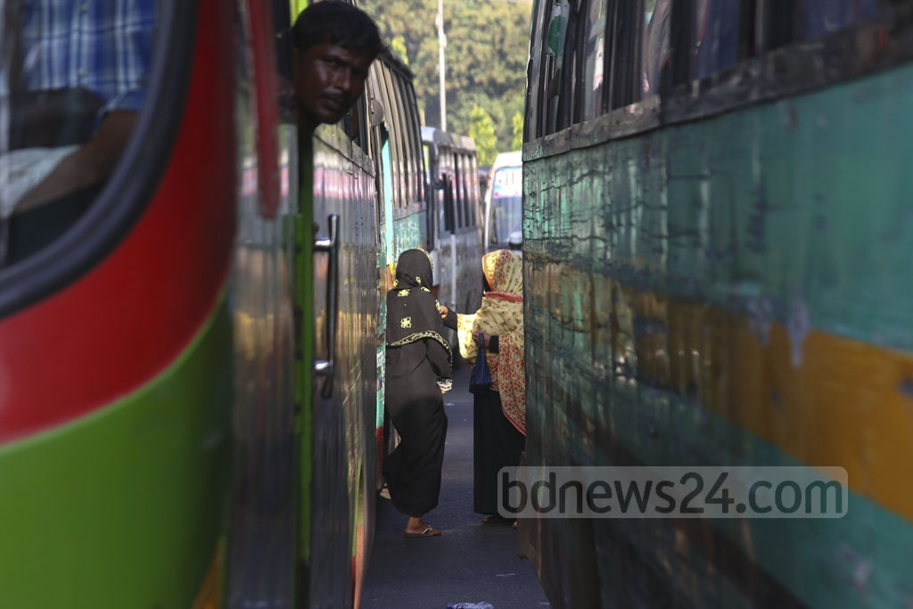 Despite numerous initiatives and programmes to ensure road safety and discipline, buses continue to stop haphazardly to pick up and drop passengers in the middle of the road. This photo was taken in the capital's Shahbag intersection on Monday. Photo: Mahmud Zaman Ovi