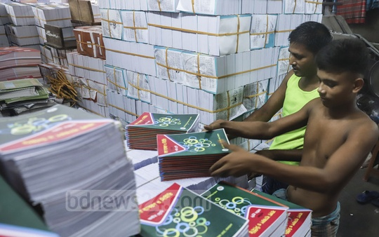 A worker arranges textbooks at a printing press in Old Dhaka's Sutrapur. Photo: Abdullah Al Momin
