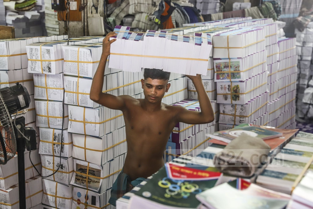 A worker is busy at a printing press at Sutrapur in Old Dhaka. Photo: Abdullah Al Momin