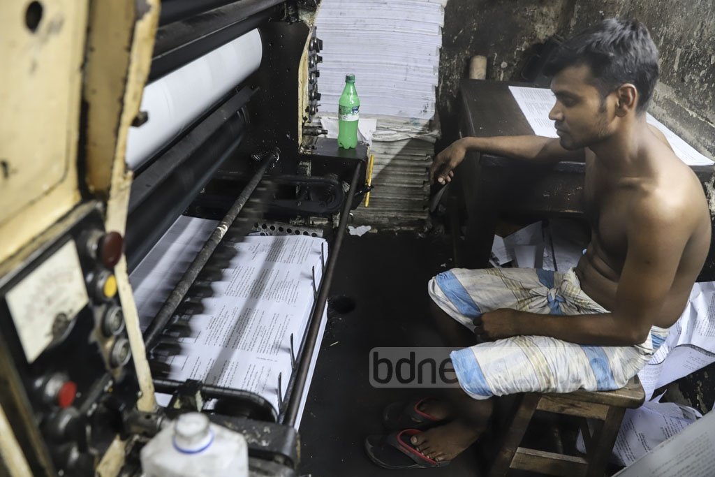 A worker prints textbooks at a plant at Sutrapur in Old Dhaka. Photo: Abdullah Al Momin