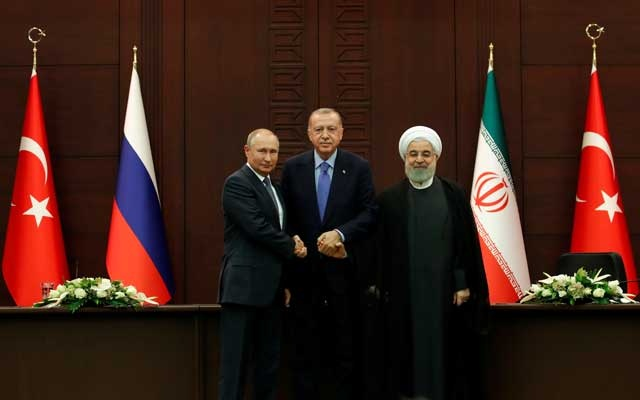 Presidents Vladimir Putin of Russia, Tayyip Erdogan of Turkey and Hassan Rouhani of Iran pose following a joint news conference in Ankara, Turkey, September 16, 2019. REUTERS