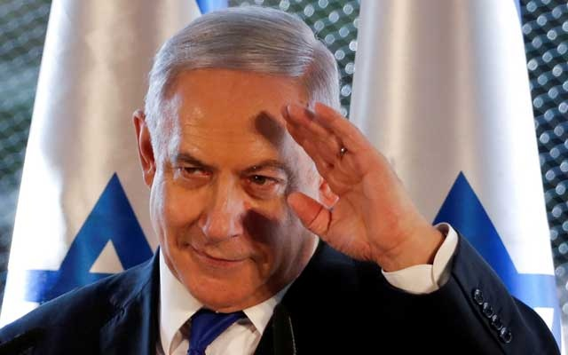 Israeli Prime Minister Benjamin Netanyahu gestures as he speaks during a state memorial ceremony at the Tomb of the Patriarchs, a shrine holy to Jews and Muslims, in Hebron in the Israeli-occupied West Bank September 4, 2019. REUTERS