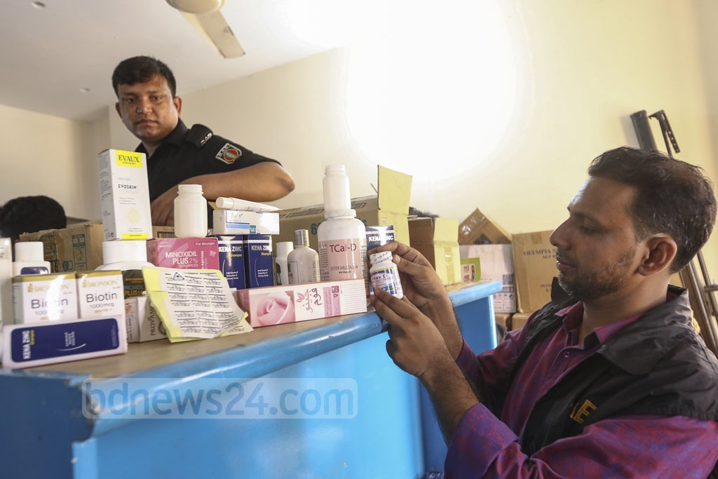 A Rapid Action Battalion mobile court has found a raft of expired medicines and cosmetics at the warehouse of Sylvan Trading Company in the capital's Hatirpool during a drive on Tuesday. Photo: Mahmud Zaman Ovi