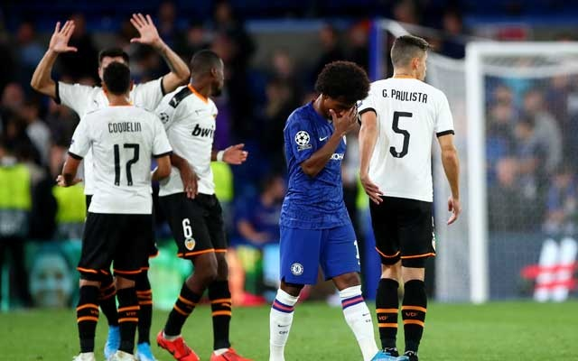 Football - Champions League - Group H - Chelsea v Valencia - Stamford Bridge, London, Britain - September 17, 2019 Chelsea's Willian looks dejected after the match as Valencia players celebrate REUTERS