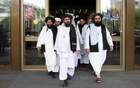 FILE PHOTO - Members of a Taliban delegation, led by chief negotiator Mullah Abdul Ghani Baradar (C, front), leave after peace talks with Afghan senior politicians in Moscow, Russia May 30, 2019. REUTERS