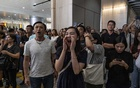 People shout at Pro-China demonstrators at a shopping mall in the Tsim Sha Tsui area of Hong Kong, on Wednesday, Sept 18, 2019. The New York Times.