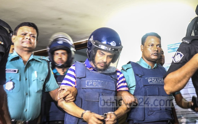 Jubo League leader Khaled Mahmud Bhuiyan being taken to a court from the Gulshan Police Station for a remand-hearing on Thursday. He has been implicated in three cases under the firearms, drugs and money laundering legislation after his arrest for running an illegal casino in Fakirapool on Wednesday. Photo: Mahmud Zaman Ovi