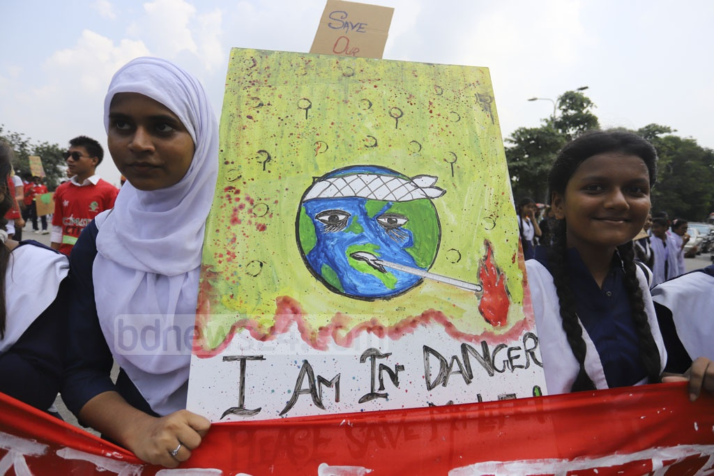 Students carrying placards during demonstration in Dhaka's parliament complex as part of global protests demanding action to stop climate change. Photo: Asif Mahmud Ove