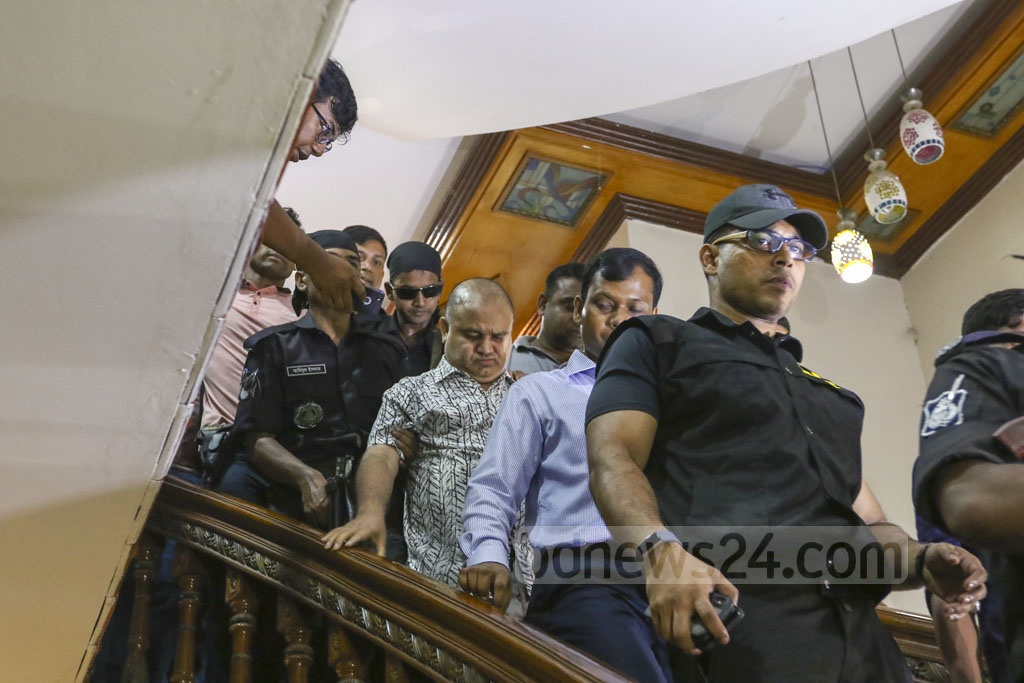 RAB personnel escorting SM Golam Kibria Shamim, a government contractor who identifies himself as a Jubo League leader, after arresting him in a raid on his office at Dhaka's Niketan on Friday. Photo: Mahmud Zaman Ovi