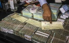 The RAB seized a huge amount of cash during a raid on GK Shamim's office.