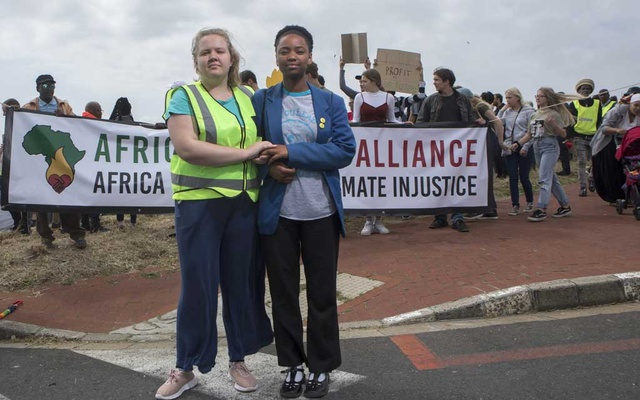Ruby Sampson and Ayakha Melithafa, of the African Climate Alliance, during in the youth led march in protest of climate change, as the demonstrators were headed toward the Houses of Parliament in Cape Town, South Africa, on Friday, Sept 20, 2019. Sampson and Melithafa are some of the local leaders among the young people around the globe that are demanding action on climate change in a day of protest. (Sydelle Willow Smith/The New York Times)
