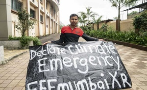 Nikhil Kalmegh, 24, with a banner while participating in a climate change protest at the AE Kalsekar Degree College in Mumbra, on the outskirts of Mumbai, India, on Friday, Sept 20, 2019. Kalmegh is one of the local leaders among the young people around the globe that are demanding action on climate change in a day of protest. (Vivek Singh/The New York Times)