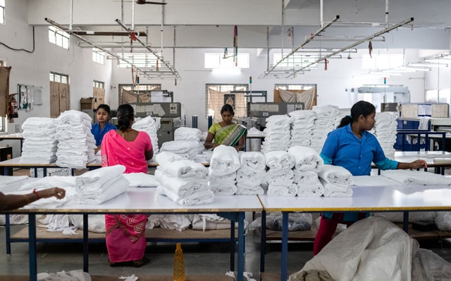 Workers sort fabric at a Dollar Industries factory in Tirupur, India, on Sept. 3, 2019. India once had the world's fastest-growing economy, but it has been battered by global and domestic forces and now its troubles are a warning sign for other developing countries. (Rebecca Conway/The New York Times)