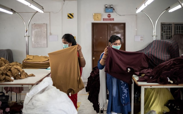 Workers at the Siva Exports factory in Tirupur, India, sort freshly stitched T-shirts on Sept. 3, 2019. India once had the world's fastest-growing economy, but it has been battered by global and domestic forces and now its troubles are a warning sign for other developing countries. (Rebecca Conway/The New York Times)
