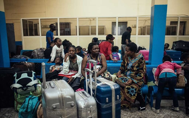 Patience Ndukwu, center, and her children fled South Africa and returned to Nigeria, leaving behind a restaurant that struggled after mob attacks began. They are pictured upon arrival, on Thursday, Sept 19, 2019, at Murtala Mohammed International airport, in Lagos. (KC Kenechukwu/The New York Times)