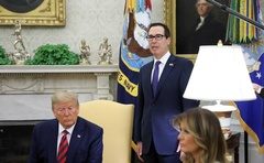 US Treasury Secretary Steven Mnuchin announces sanctions on the Central Bank of Iran as he stands behind US President Donald Trump and first lady Melania Trump in the Oval Office during a meeting with Australia's Prime Minister Scott Morrison at the White House in Washington, US September 20, 2019. REUTERS