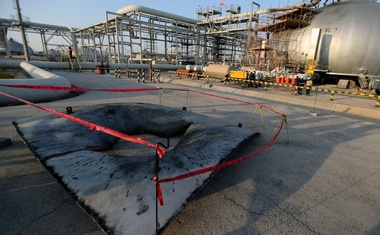 A metal part of a damaged tank is seen at the damaged site of Saudi Aramco oil facility in Abqaiq, Saudi Arabia, September 20, 2019. REUTERS