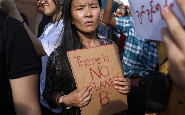 Protesters hold placards as they attend a climate change demonstration in Yangon, Myanmar, September 22, 2019. REUTERS