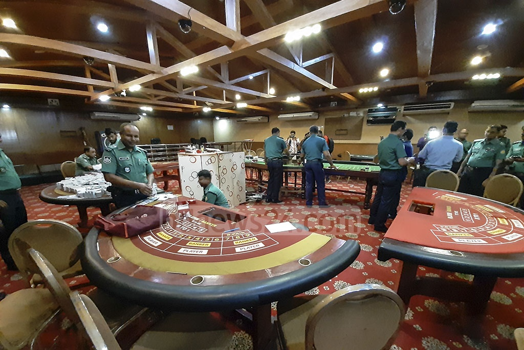 Police conducting a raid on the Dilkusha Sporting Club in the capital's Motijheel as part of the crackdown on illegal gambling establishments on Sunday. Photo: Abdullah Al Momin