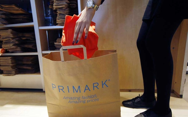 A sales assistant packs clothes at a Primark store on Oxford Street in London June 20, 2014. Reuters