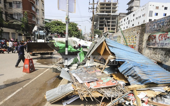 Jobo League and Swechchhasebak League offices built on the footpaths in Sector-3 in Uttara were among the illegal structures demolished by Dhaka North City Corporation in an eviction drive on Sunday. Photo: Asif Mahmud Ove
