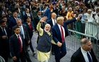 Prime Minster Narendra Modi of India, left, holds President Donald Trump's hand as they walk through a rally for Modi, at the NRG Stadium in Houston, Sept 22, 2019. The New York Times.